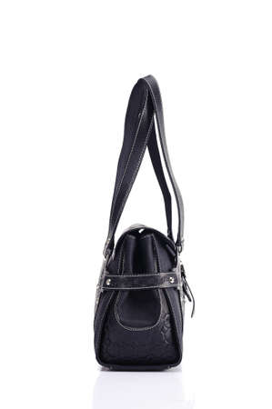 black leather texture: Leather ladies bag on a white background. Beautiful, fashionable, accessory, isolated. Interesting design, the texture of the skin. Comfortable handle.