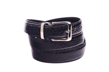 chrome man: Belt male leather.The fashionable accessory is twisted on a white background.With a metal buckle.Natural animal skin.