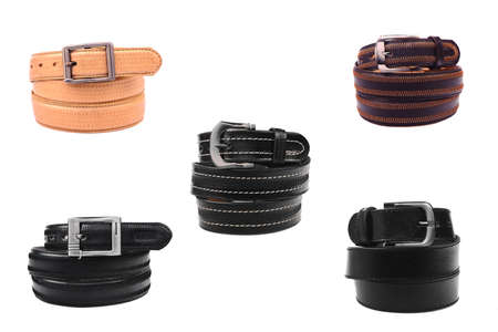 Set Belt male leather.The fashionable accessory is twisted on a white background.With a metal buckle.Natural animal skin. Stock Photo