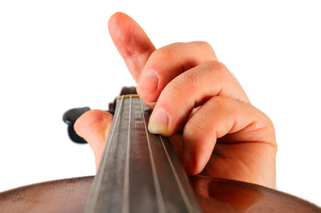 violinista: Image violin lies in a human hand.String instrument isolated on white background.Fingers play music