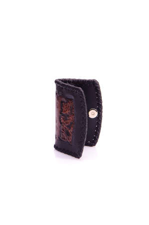 leather texture: One purse, genuine leather with embossing ,black brown colors,Fashionable mens accessory To store money on a white background