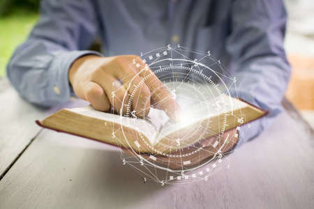 Educational Business and Technology concept. Old book in mans hands