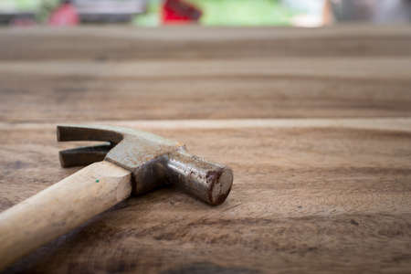 claw hammer: Old hammer on wood background Stock Photo