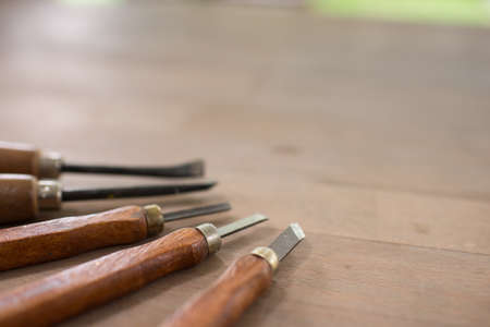 Close up wood carving tools on table