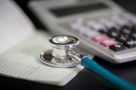 Finance accounting Medical treatment ,Stethoscope and calculator,book bank concept