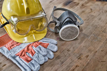 Standard construction safety equipment on wooden table. top view High Dynamic Range yone Stock Photo