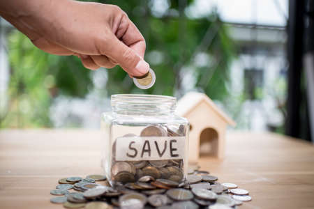 Concept of saving money for house.Business Finance and Money concept,Save money for prepare in the future