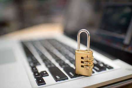 Cyber safety concept, locked and key on laptop computer keyboard