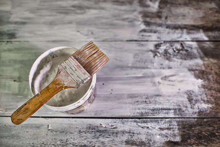 White paint tin and paint brush on the table High Dynamic Range tone Stock Photo
