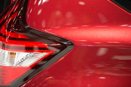 Close-up on generic rear light of a car on red background Stock Photo