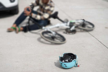 Unconscious Man Cyclist Lying On Road After Road Accident 免版税图像