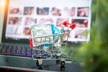 Condoms shopping cart depicting the idea of paying for sex online