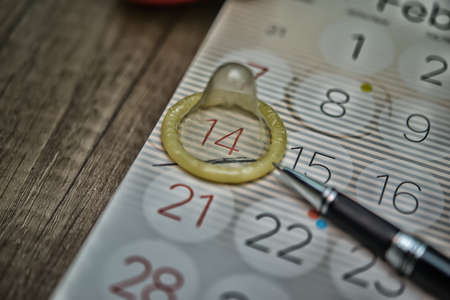 condom on the calendar with the date of February 14 Valentine's day,High Dynamic Range tone
