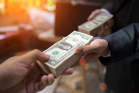 Hand businessman paying money for contact business