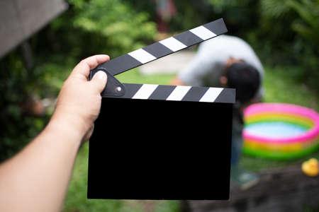 Clapper board,Movie clapper in hand and make movie background blur