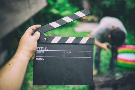 Clapper board,Movie clapper in hand and make movie background blur,film tone