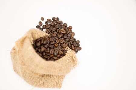 Coffee beans in Cloth bag isolated on white background