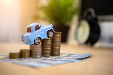 Collect money to buy cars in the future Saving money concept