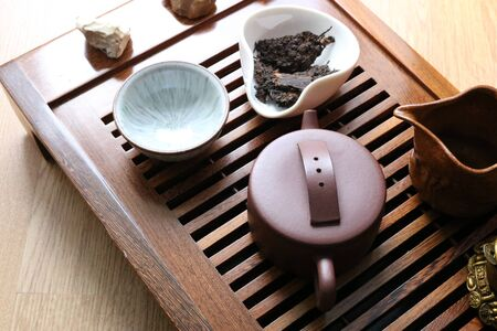 Chinese tea ceremony using tea utensils made of glass and porcelain.
