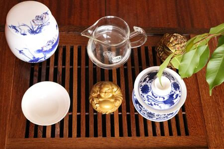 Chinese tea ceremony using tea utensils made of glass, clay and porcelain.