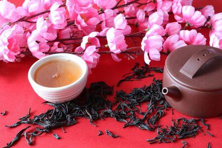 Chinese tea ceremony on the background of Sakura flowers.