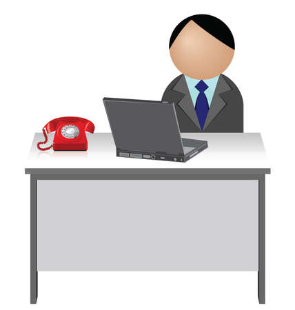 work table: Male worker sat at his desk with telephone and laptop