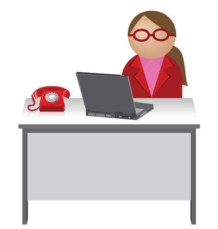 Female worker sat at her desk with telephone and laptop