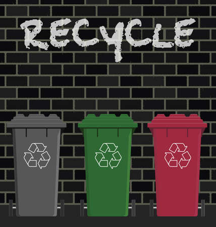 biodegradable: Recycling wheelie bins against a brick wall