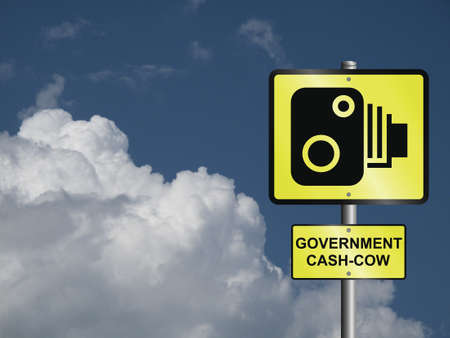 disgraceful: Comical government road speed camera sign against a cloudy blue sky