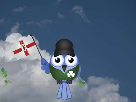 compatriot: Comical Irish flag waving bird Patriot sat on a tree branch against a cloudy blue sky