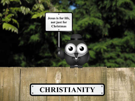 vicar: Comical bird vicar with Christianity and Jesus is for life sign perched on a timber garden fence against a foliage background