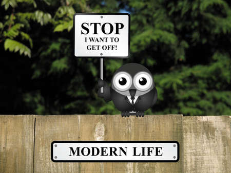 relating: Comical bird with stop I want to get off sign relating to pressures of modern life perched on a timber garden fence against a foliage background