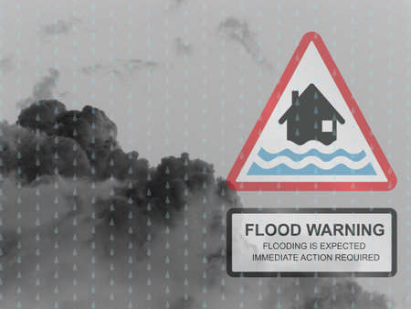 torrent: Red flood warning sign against a dark raining cloudy skyscape Stock Photo
