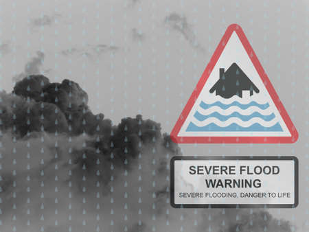 torrent: Severe flood warning sign against a dark raining cloudy skyscape Stock Photo