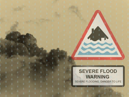monsoon clouds: Severe flood warning sign against a dark raining cloudy skyscape Stock Photo