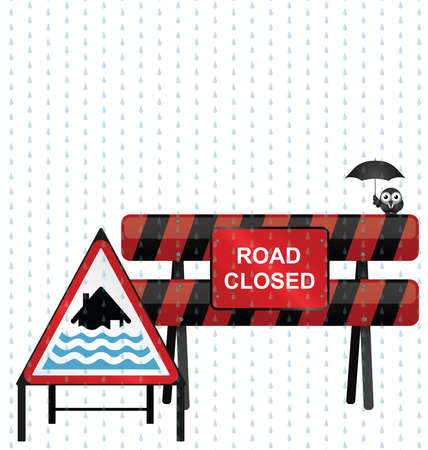 torrential rain: Road closed barrier and severe flood warning sign