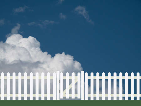 White picket fence and gate against a cloudy sky backdrop