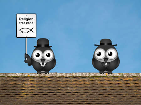 Comical religion free zone sign with bird vicar perched on a rooftop against a clear blue sky