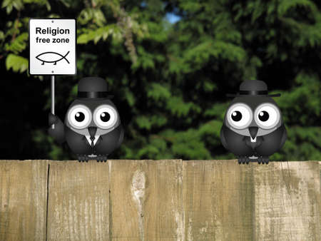 theological: Comical religion free zone sign with bird vicar perched on a timber garden fence against a foliage background Stock Photo
