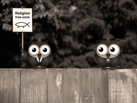 atheism: Sepia comical religion free zone sign with bird vicar perched on a timber garden fence against a foliage background