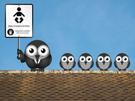Comical baby changing facilities sign with parent and young birds perched on a rooftop against a clear blue sky