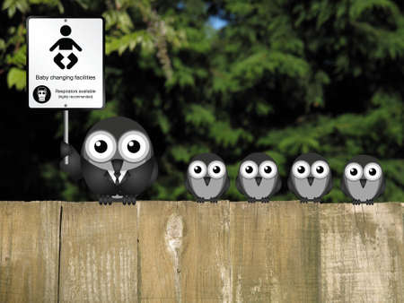 Comical baby changing facilities sign with parent and young birds perched on a wooden fence Stock Photo