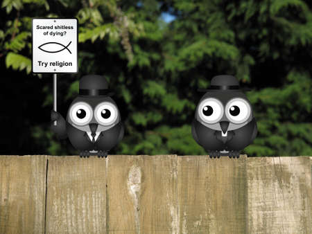 clergy: Comical scared of life try religion sign with bird atheist and bird vicar perched on a wooden fence Stock Photo