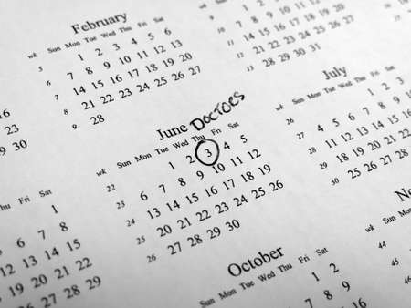 centred: Generic calendar with doctors appointment circled with shallow depth of field centred  on highlighted date