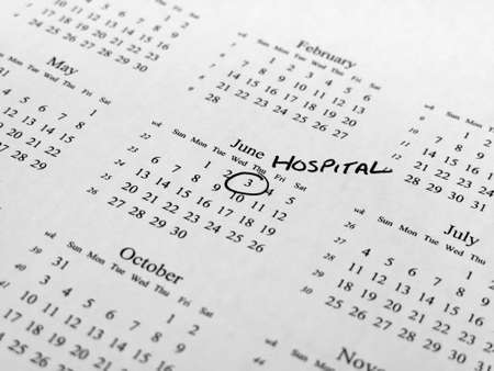 centred: Generic calendar with hospital appointment circled with shallow  depth of field centred on highlighted date Stock Photo