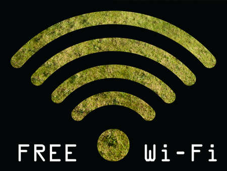 Free WIFI sign with grass visible through graphics on black background