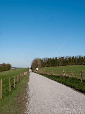 grass verge: Single lane road through countryside and farmland