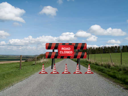 resurfacing: Road closed sign on barrier due to resurfacing work on single country lane through countryside and farmland Stock Photo