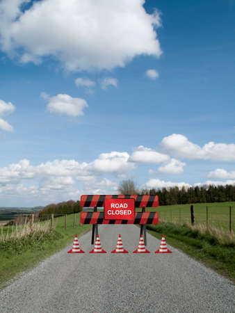 wire: Road closed sign on barrier due to resurfacing work on single country lane through countryside and farmland Stock Photo