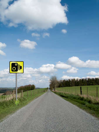 grass verge: Roadside speed camera on single country lane through countryside and farmland Stock Photo